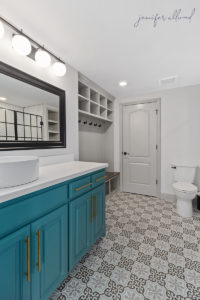 Bright and Modern Bathroom with Geometric Tile and Blue Cabinets