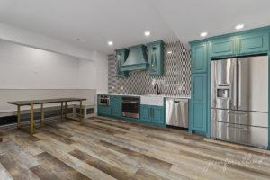 Basement Kitchen Remodel with Bright Blue Cabinets and Geometric Tile Backsplash