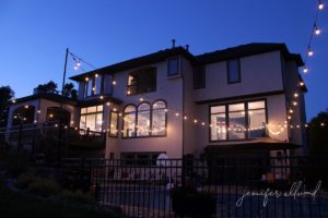 string lights and exterior house paint at dusk