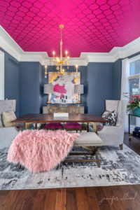 glamorous dining room with pink accents